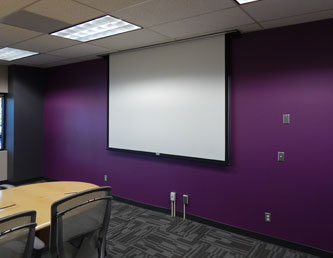 Custom retractable projection screens by Commercial Systems